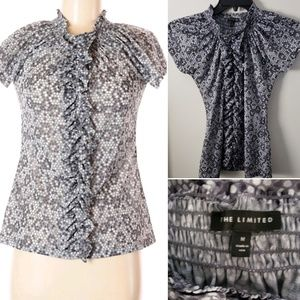 The limited blouse  with ruffle detail size Medium